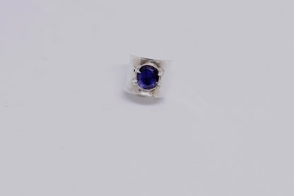 'Blue ambassador' Iolite Silver Ring Adorned with Prong Logo Pattern